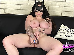 bodacious batgirl plays with her taut pink cunny