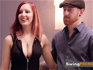 red-haired duo gets prepped to soiree in the red apartment with other swingers