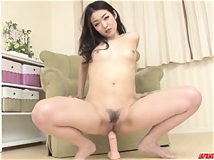 Ryu Enami works playthings over her pussy and rump
