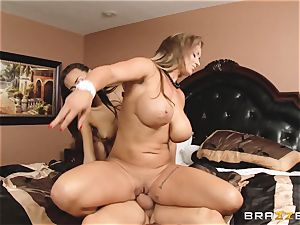 Eva Notty flashes her stepdaughter Janice Griffith how to sate a spear